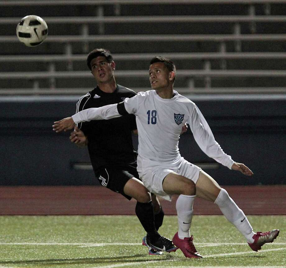 Westside's Jonathan Garay left, and Chavez' Angel Garcia during the first half of boys high school soccer game action at HISD's Barnett Stadium Tuesday, Feb. 5, 2013, in Houston. Photo: James Nielsen, Chronicle / © Houston Chronicle 2013