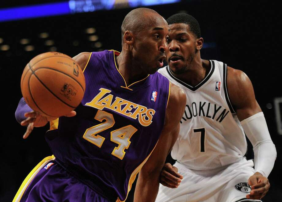 Los Angeles Lakers' Kobe Bryant drives the ball past Brooklyn Nets Joe Johnson during their NBA game at the Barclays Center in the Brooklyn borough of New York City, February 5, 2013.  AFP PHOTO/Emmanuel DunandEMMANUEL DUNAND/AFP/Getty Images Photo: EMMANUEL DUNAND