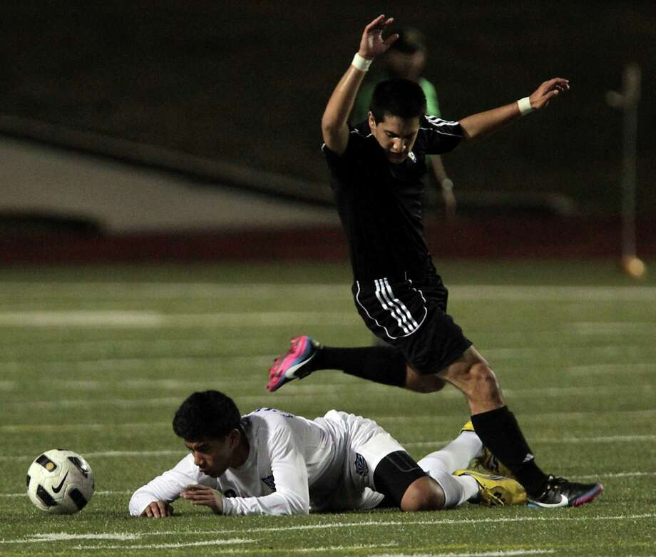 Chavez' Hervin Vasquez left, and Westside's Joseph Baez during the first half. Photo: James Nielsen, Chronicle / © Houston Chronicle 2013