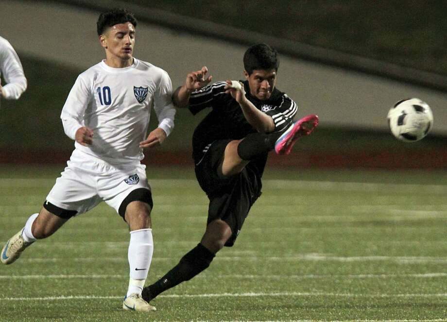 Chavez' Julio Portillo left, and Westside's Jonathan Garay chase the ball. Photo: James Nielsen, Chronicle / © Houston Chronicle 2013