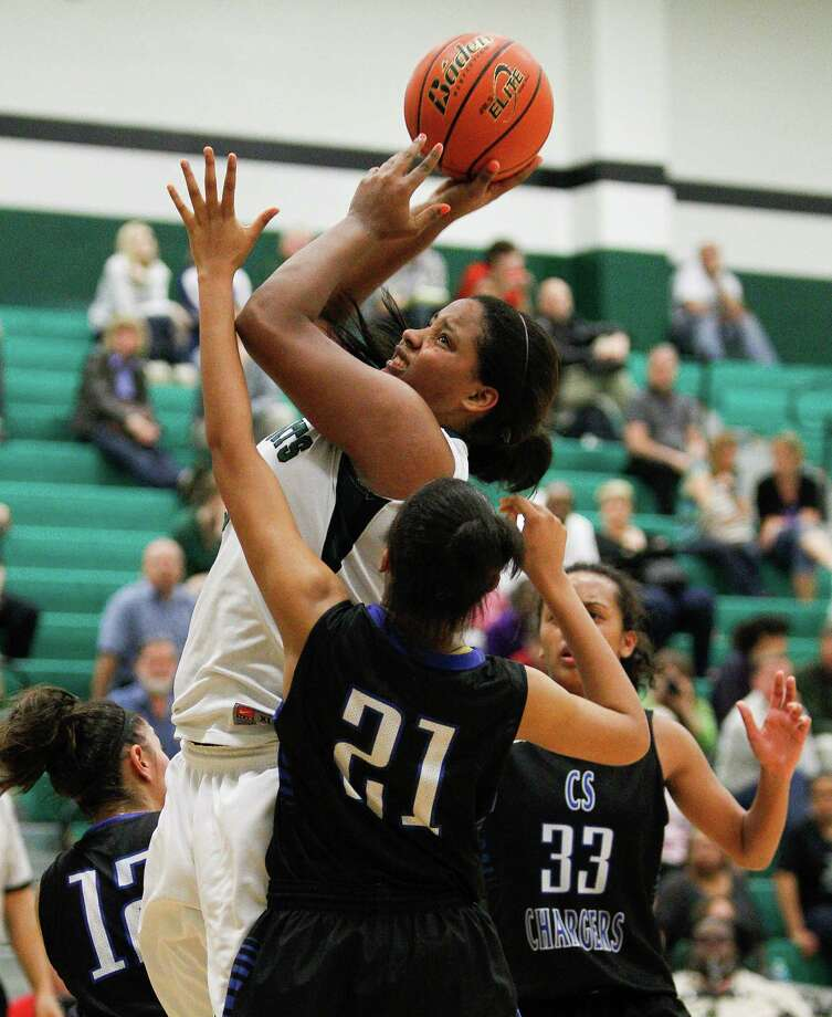 Read about Clear Springs' 74-48 win against Clear Falls.Clear Falls' Erin Farmer (55) drives strong to the basket over Clear Springs' Ryshinique Ball (21). Photo: Bob Levey, Houston Chronicle / ©2013 Bob Levey