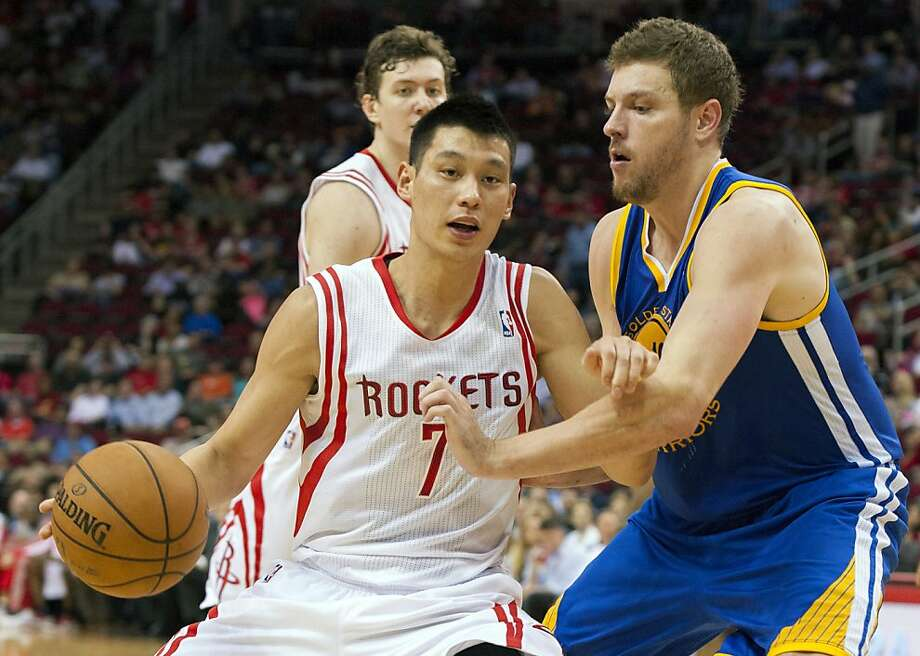 Houston Rockets' Jeremy Lin (7) drives against Golden State Warriors' David Lee, right, during the third quarter of an NBA basketball game, Tuesday, Feb. 5, 2013, in Houston. The Rockets beat the Warriors 140-109. (AP Photo/Dave Einsel) Photo: Dave Einsel, Associated Press