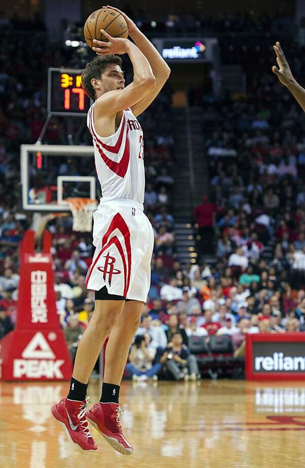Houston Rockets' Chandler Parsons shoots and scores a 3-point basket during the third quarter of an NBA basketball game against the Golden State Warriors, Tuesday, Feb. 5, 2013, in Houston. The Rockets beat the Warriors 140-109. (AP Photo/Dave Einsel) Photo: Dave Einsel, Associated Press
