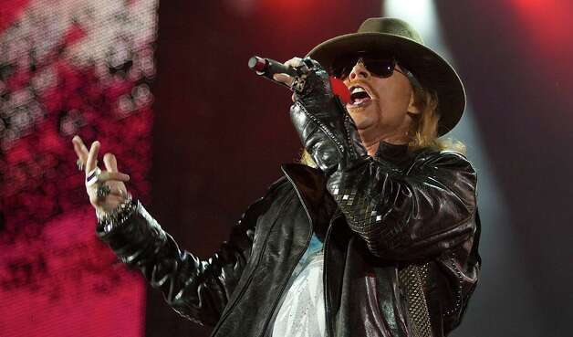 "FILE - In this Dec. 16, 2010 file photo, Axl Rose, lead singer of the rock band, ""Guns N' Roses,"" performs during a concert on the Yas Island in Abu Dhabi, United Arab Emirates.  The group was nominated for induction into the Rock and Roll Hall of Fame. The Rock and Roll Hall of fame induction ceremony will be held in Cleveland, where the rock hall is based, on April 14. (AP Photo/Nousha Salimi, file) Photo: Nousha Salimi / AP2010"