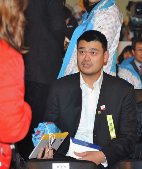 Chinese basketball star Yao Ming takes part in the opening ceremony of the Special Olympics World Winter Games for athletes with intellectual disabilities in Pyeongchang, South Korera, Tuesday, Jan. 29, 2013. (AP Photo/Kim Jae-hwan,Pool) Photo: Kim Jae-hwan, POOL / Pool AFP