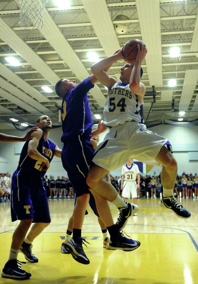 CBA's Greig Stire goes in for a basket during their high school boy's basketball game against Troy on Tuesday Feb. 5, 2013 in Colonie, N.Y. .(Michael P. Farrell/Times Union) Photo: Michael P. Farrell