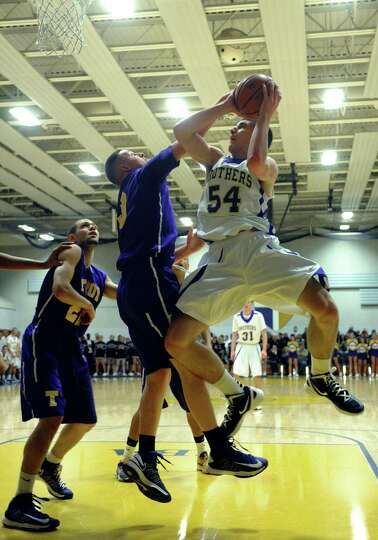 CBA's Greig Stire goes in for a basket during their high school boy's basketball game against Troy o