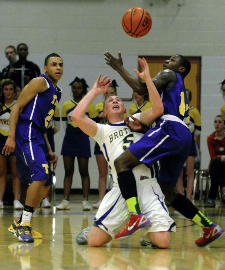 CBA's Nick Marini and Troy's Dyaire Holt battle for a loose ball during their high school boy's basketball on Tuesday Feb. 5, 2013 in Colonie, N.Y. .(Michael P. Farrell/Times Union) Photo: Michael P. Farrell