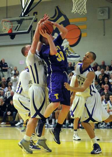 Troy's Liam Testo goes in for a score during their high school boy's basketball game against CBA on