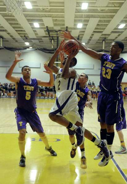 CBA's Tyrell Ramsey drives to the basket during their high school boy's basketball game against Troy