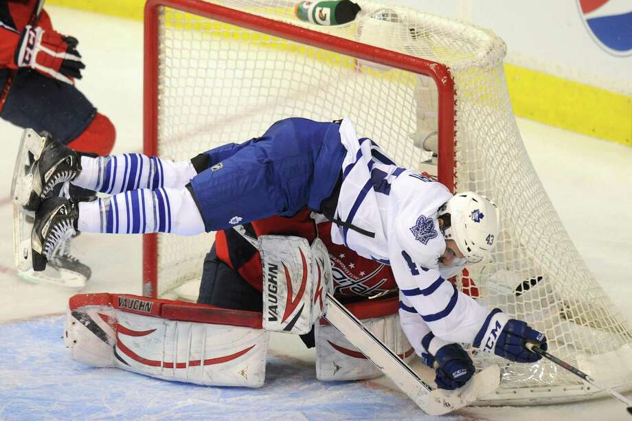 Capitals goalie Michal Neuvirth has an intruder in his crease in Maple Leafs center Nazem Kadri. Photo: Mitchell Layton, STR / MCT