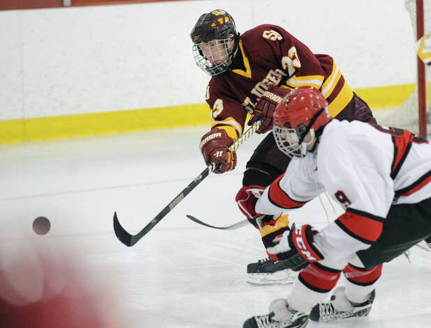 At left, Sean Smith # 23 of St. Joseph clears the puck while being defended by Alex Bastone # 9 of Greenwich during the boys high school ice hockey game between St. Joseph High School and Greenwich High School at Hamill Rink in Byram, Tuesday night, Feb. 5, 2013. St. Joseph defeated Greenwich, 5-2. Photo: Bob Luckey / Greenwich Time