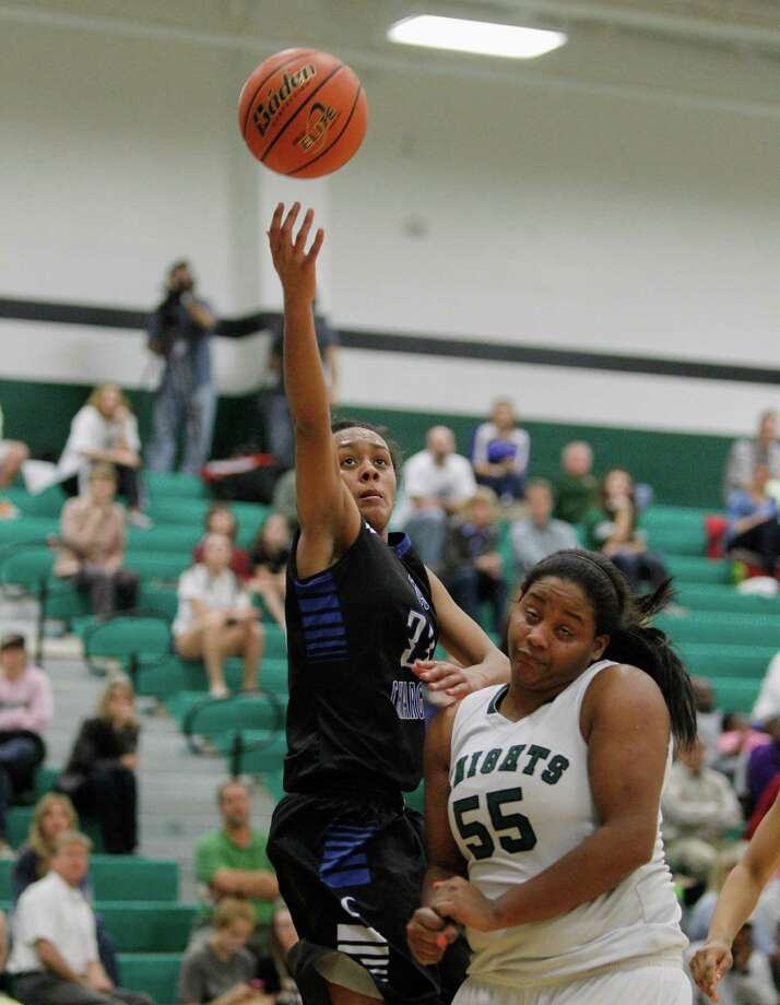 Clear Springs' Courtnie Latham, left, hits a runner at the first-half buzzer as Clear Falls' Erin Farmer tries to avoid committing a foul. Photo: Bob Levey, Photographer / ©2013 Bob Levey