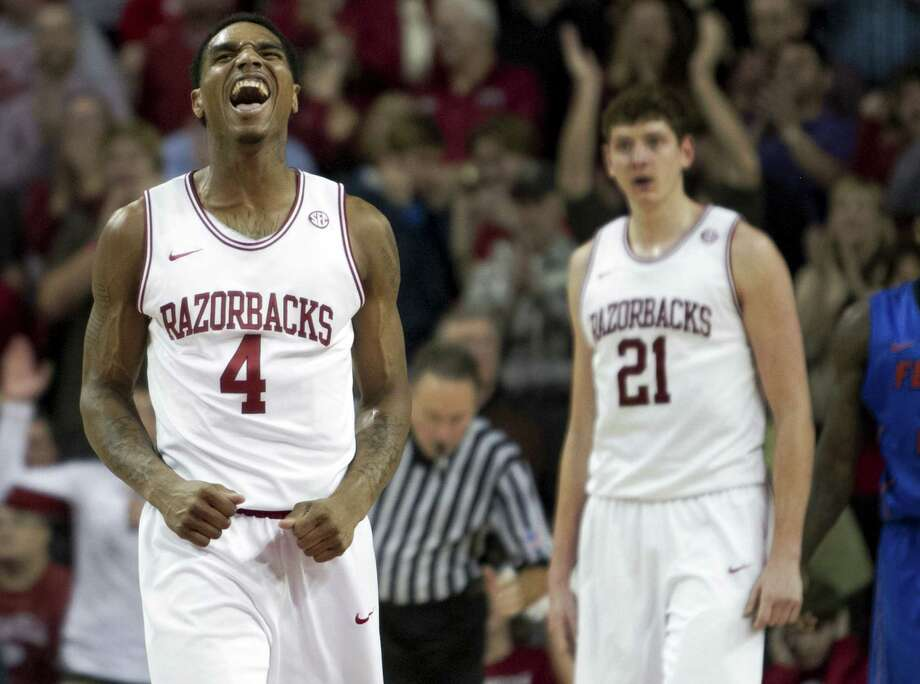 Arkansas' Coty Clarke exults during the Razorbacks' 80-69 victory over No. 2 Florida in Fayetteville, Ark. Photo: Gareth Patterson / Associated Press