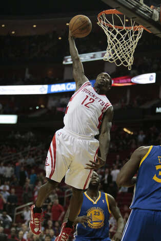 Rockets guard Patrick Beverley lays down an emphatic dunk in the fourth quarter. Photo: Billy Smith II / © 2013 Houston Chronicle