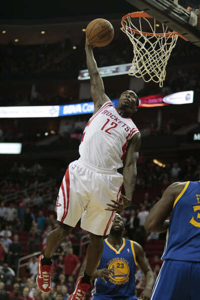 Rockets guard Patrick Beverley lays down an emphatic dunk in the fourth quarter.