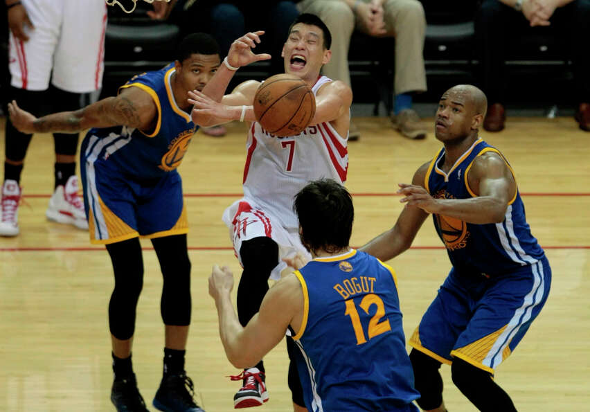 Rockets guard Jeremy Lin is fouled while attempting to drive to the basket.