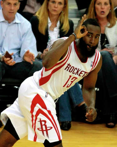 Rockets guard James Harden gives his signature hand gesture after connecting on a 3-point shot. Photo: Billy Smith II / © 2013 Houston Chronicle