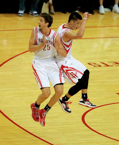 Chandler Parsons and Jeremy Lin of the Rockets celebrate a made basket. Photo: Billy Smith II / © 2013 Houston Chronicle