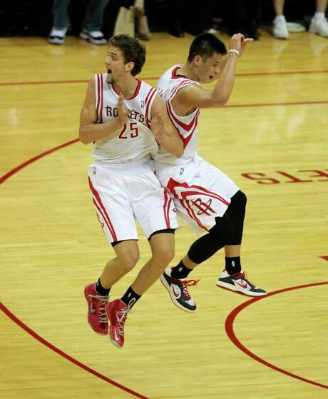 Chandler Parsons, left, who had four of the Rockets' 23 3-pointers Feb. 5, celebrates one of Jeremy Lin's five 3s. Both anticipate a lively Warriors rematch. Photo: Billy Smith II, Staff / © 2013 Houston Chronicle