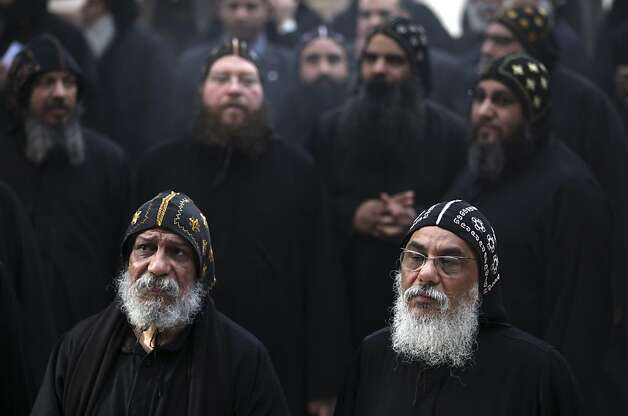 Clergymen gather to wait for the arrival of Egypt's Coptic Christian Pope Tawadros II, at the historic al-Muharraq Monastery, a centuries-old site some 180 miles (300 kilometers) south of Cairo in the province of Assiut, Egypt, Tuesday, Feb. 5, 2013. Egypt's Coptic Christian pope sharply criticized the country's Islamist leadership in an interview with The Associated Press on Tuesday, saying the new constitution is discriminatory and Christians should not be treated as a minority. Photo: Khalil Hamra, Associated Press