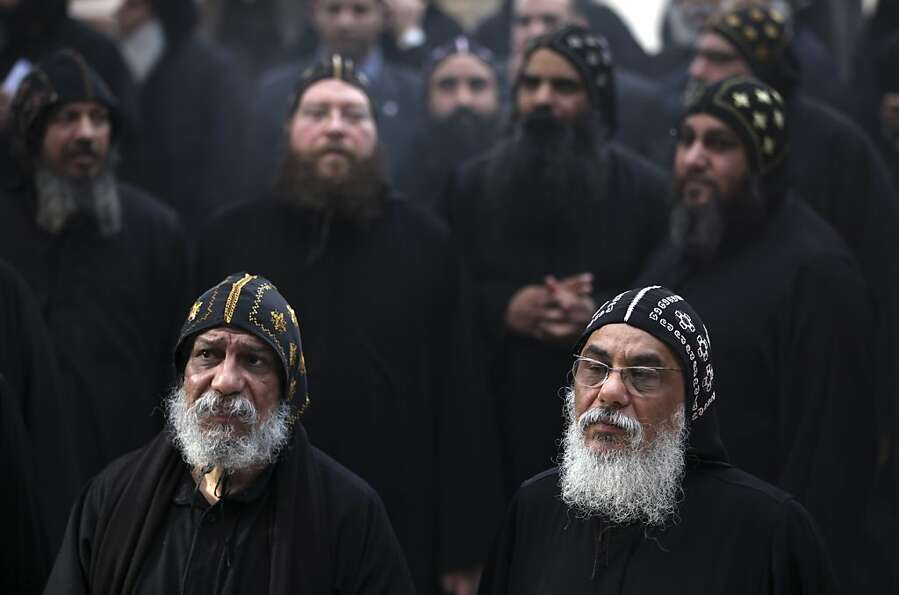 Clergymen gather to wait for the arrival of Egypt's Coptic Christian Pope Tawadros II, at the histor