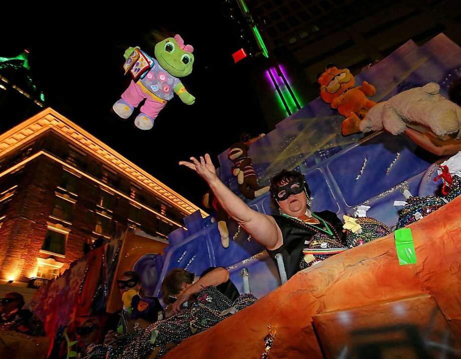 A Member of the Order of LaShe's throws a stuffed animal to the crowd during their Mardi Gras parade downtown Mobile, Ala., Tuesday, Feb. 5, 2013. Photo: Bill Starling, Associated Press