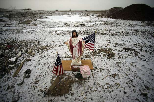 "A religious statue and flags sit near empty lots where homes destroyed by Superstorm Sandy were torn down in Union Beach, N.J. on Tuesday, Feb. 5, 2013. New Jersey Gov. Christie told a gathering in Union Beach Tuesday that the National Flood Insurance Program's handling of claims in New Jersey ""has stunk,"" complaining that the program has been far too slow to resolve claims from Superstorm Sandy, with 70 percent of cases unresolved three months after the disaster. Photo: Mel Evans, Associated Press"