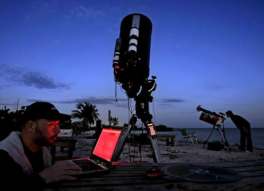 In this Monday, Feb. 4, 2013 photo provided by the Florida Keys News Bureau, Canadian Darryl Archer begins observing celestial objects during the first evening of the six-day Winter Star Party on Scout Key, Fla. Some 500 amateur and professional astronomers are in the lower Florida Keys to observe southern constellations, stars, planets and even the International Space Station. The Keys' southern location, clear night skies and observing locations, void of bright city lights, help create optimal viewing conditions for participants. Photo: Rob O'Neal, Associated Press