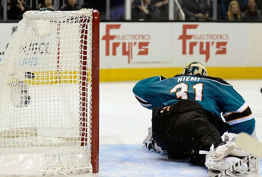 The Sharks' Antti Niemi looks at what's happening behind his back - Patrick Kane's first goal. Photo: Thearon W. Henderson, Getty Images