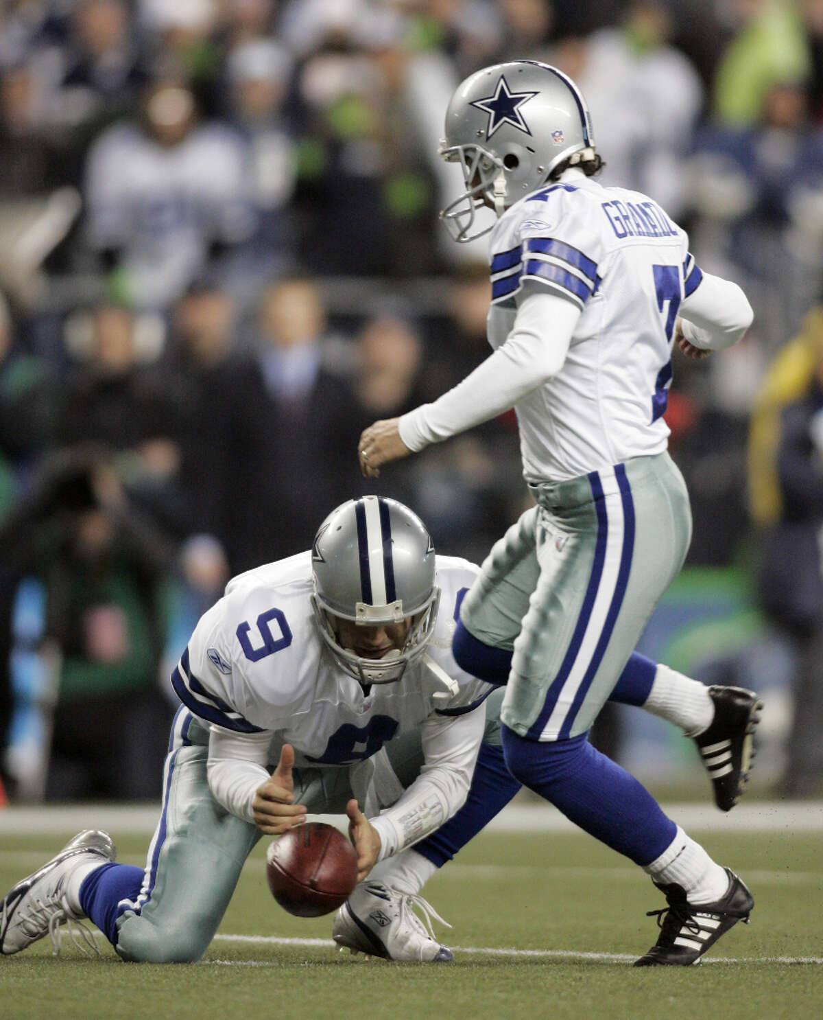 In this Jan. 6, 2007, file photo, Dallas Cowboys' Tony Romo, left, bobbles the snap as kicker Martin Gramatica steps in for the kick with 1:19 left in the game against Seattle Seahawks in an NFC wild card playoff football in Seattle. Romo attempted to run the ball but fumbled as he was hit. The Seahawks won 21-20.