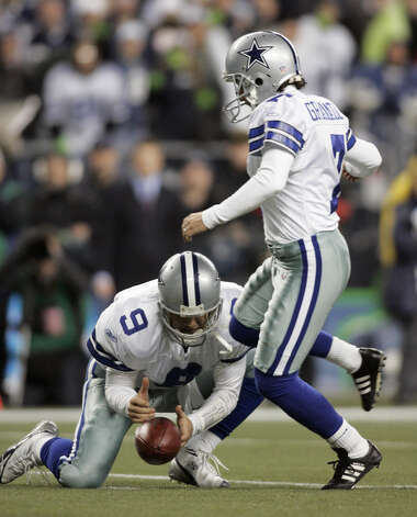 In this Jan. 6, 2007, file photo, Dallas Cowboys' Tony Romo, left,  bobbles the snap as kicker Martin Gramatica steps in for the kick with 1:19 left in the game against Seattle Seahawks in an NFC wild card playoff football in Seattle. Romo attempted to run the ball but fumbled as he was hit. The Seahawks won 21-20. Photo: John Froschauer, Associated Press / AP