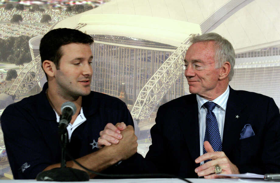 In this Oct. 30, 2007 photo, Dallas Cowboys quarterback Tony Romo, left, shakes hands with team owner Jerry Jones during a news conference at team headquarters in Irving, Texas. The Dallas Cowboys haven't won a championship in 15 years, the longest wait in franchise history. As owner and general manager, Jones has been blamed for letting his ego get in the way. Photo: LM Otero, AP / 2007 AP