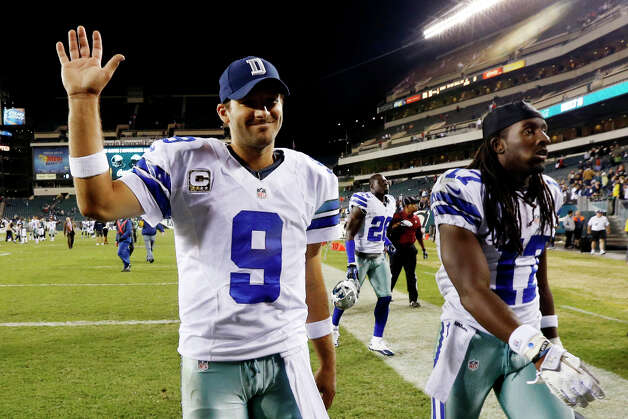 Dallas Cowboys quarterback Tony Romo, left, and wide receiver Dwayne Harris walk off the field after an NFL football game against the Philadelphia Eagles, Sunday, Nov. 11, 2012, in Philadelphia. Dallas won 38-23. Photo: Julio Cortez, Associated Press / AP