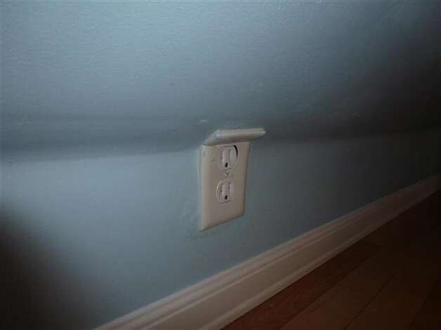 Outlet doesn't fit? Break it and bend it! Photo via Zillow Blog.