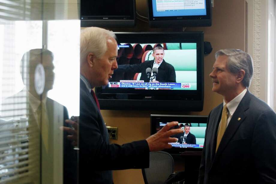 President Barack Obama is seen on a television screen speaking live about the Keystone XL pipeline from Cushing, Okla., as Sen. John Cornyn, R-Texas, and Sen. John Hoeven, R-N.D. talk before the start of their news conference about the same oil pipeline, Thursday, March 22, 2012, on Capitol Hill in Washington. Photo: Charles Dharapak, Associated Press / AP