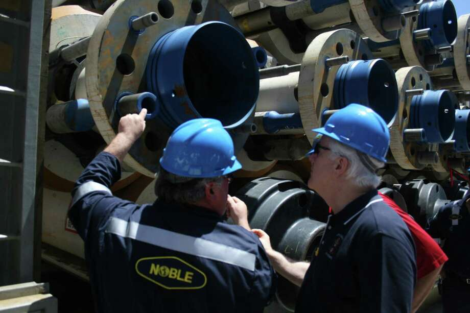 Noble Corp. division manager Tommy Travis shows pieces of a riser package to Sen. John Cornyn aboard the Noble Danny Adkins rig in the Gulf of Mexico on July 6, 2010. Photo: Loren Steffy, Houston Chronicle / Houston Chronicle