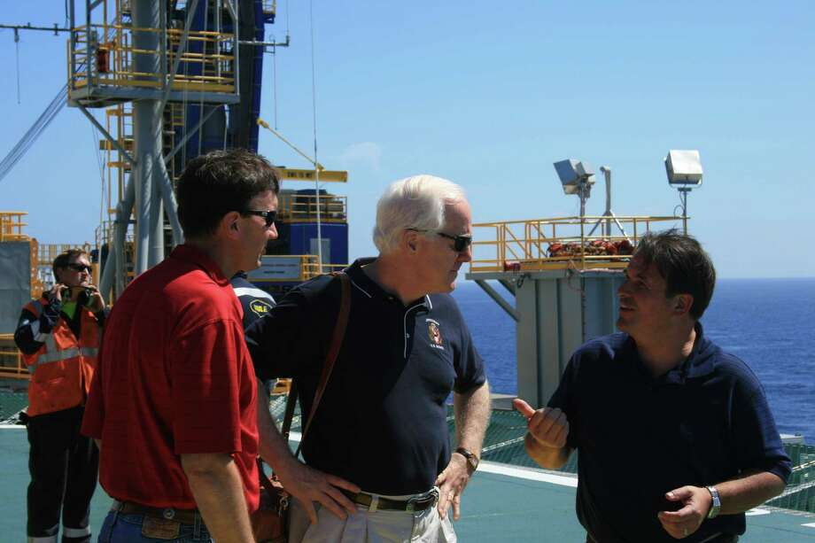 Rep. Pete Olson and Sen. John Cornyn talk with Noble Corp.'s John Breed aboard Noble's Danny Adkins drilling rig in the Gulf of Mexico on July 6, 2010. Photo: Houston Chronicle / DirectToArchive