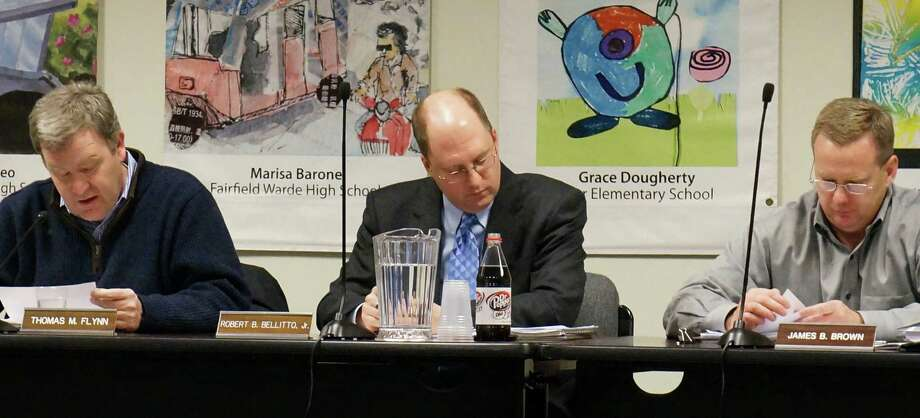 Fairfield Board of Finance members, from left, Chairman Thomas Flynn, Vice Chairman Robert Bellitto Jr. and James Brown discuss proposed bonding for more than $1 million in capital projects at Tuesday's meeting.  FAIRFIELD CITIZEN, CT 2/5/13 Photo: Genevieve Reilly / Fairfield Citizen