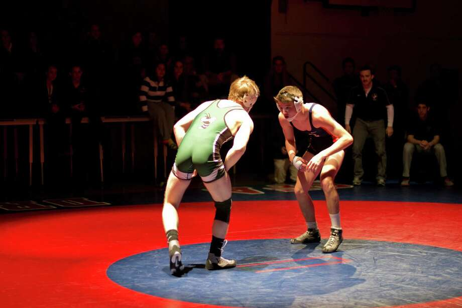 Greens Farms Academy freshman George Garland, right, wrestles at 145 pounds in a match against Hamden Hall on Feb. 2 at home. The Dragons won the meet 39-30. Photo: Contributed Photo / Norwalk Citizen