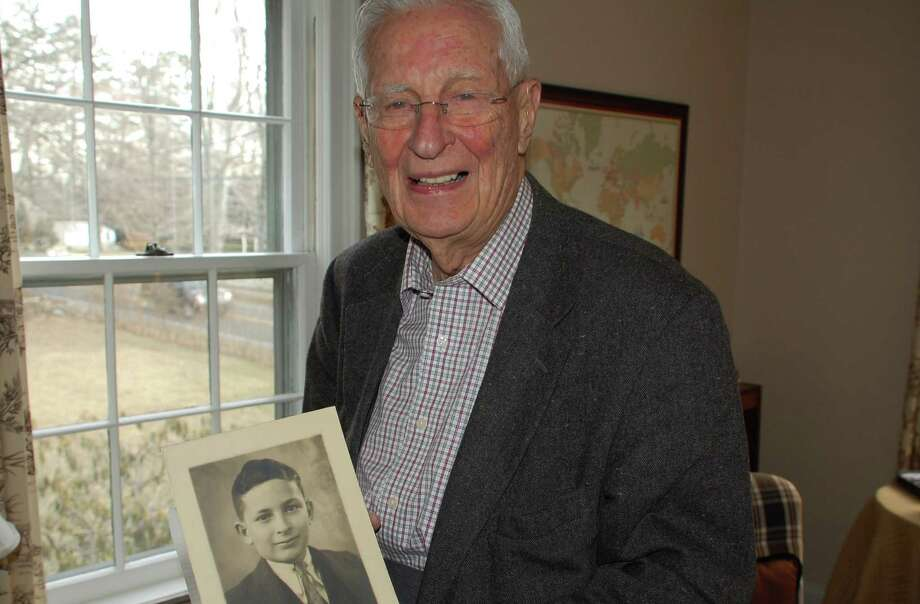 "Allen Raymond Jr., who at 90 is Westport's town historian and still active in many civic endeavors, shows a photo of himself a photo of himself at age 11 in 1934 from Buffalo, N.Y., following a piano recital. It reads, ""In appreciation of your excellent performance in the Julliard Series."" Photo: Jarret Liotta / Westport News contributed"