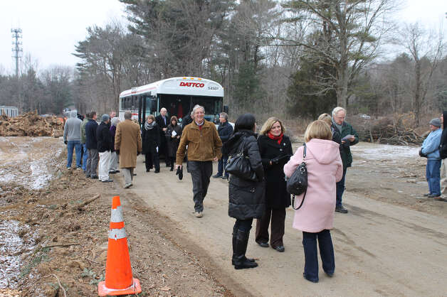 Attendees arrive on site by shuttle van, having parked in the nearby commuter parking lot at Exit 41 of the Merritt Parkway