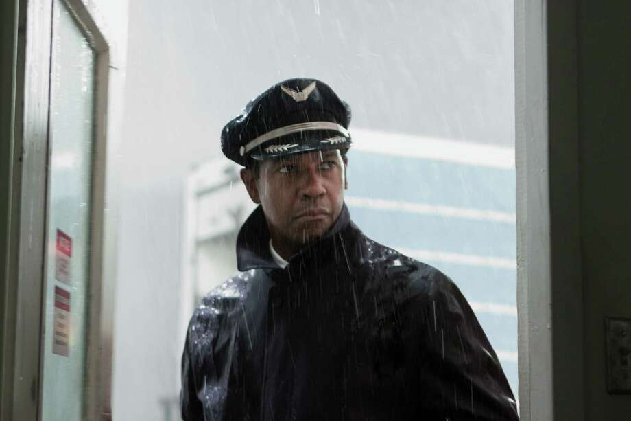 "This film image released by Paramount Pictures shows Denzel Washington portraying Whip Whitaker in a scene from ""Flight."" Washington plays an airline pilot who, despite being hung-over, drunk and coked-up, manages to bring down a rapidly deteriorating plane in a daring emergency landing on what should have been a routine flight between Orlando, Fla., and Atlanta.  (AP Photo/Paramount Pictures, Robert Zuckerman) Photo: Robert Zuckerman / Paramount Pictures"