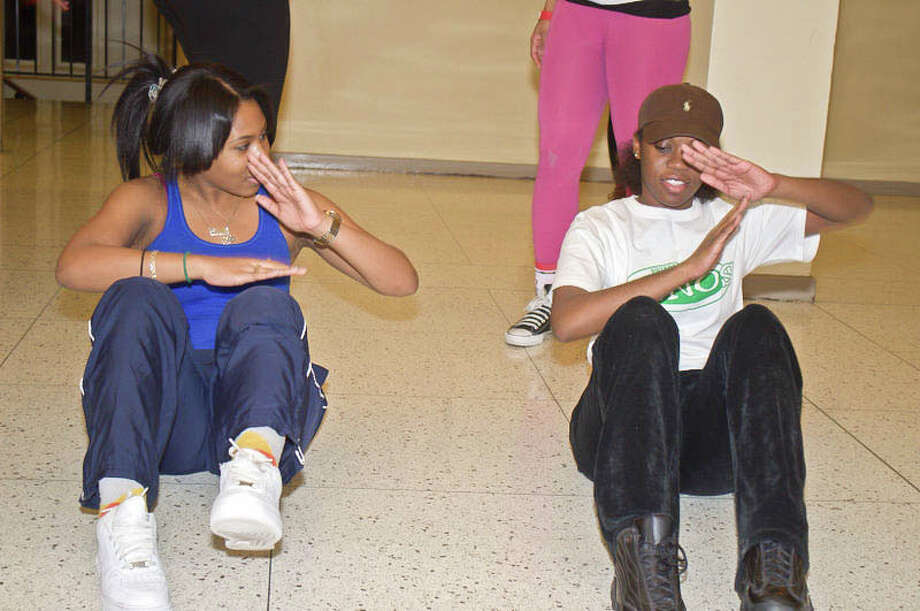 Two Precizun members rehearse for their performance in the upcoming step show at the Palace Theatre. (Photo by Junior D. Senat) Photo: Picasa