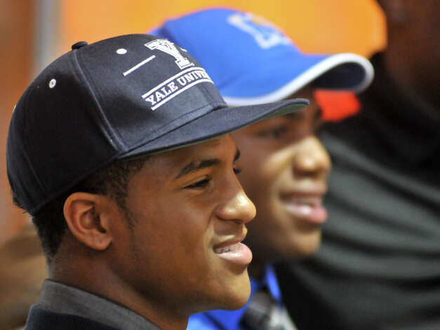Madison High School football players Galen McAllister (left) and Marquis Warford smile during National Signing Day Wednesday. McAllister will play Yale and Warford will play at the University of Memphis. Photo: Robin Jerstad