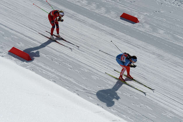 Athletes compete during 6 x 1,25 km Ladies' Classic Team Sprint of FIS Cross Country skiing World Cup at Laura Cross Country and Biathlon Center in Russian Black Sea resort of Sochi on February 3, 2013. Finland's Mona-Lisa Malvalehto and Anne Kylloenen took the first place ahead of Russia's Julia Ivanova and Natalia Matveeva and Canada's Perianne Jones and Daria Gaiazova. Photo: KIRILL KUDRYAVTSEV, AFP/Getty Images / 2013 AFP