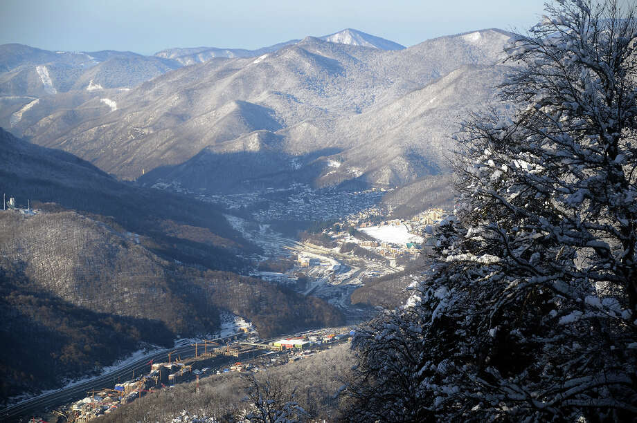 A general view of villages of Esto-Sadok (L) and Krasnaya Polyana (C) close to the alpine resort Rosa Khutor in Russian Black Sea resort of Sochi on February 3, 2013. Photo: KIRILL KUDRYAVTSEV, AFP/Getty Images / 2013 AFP