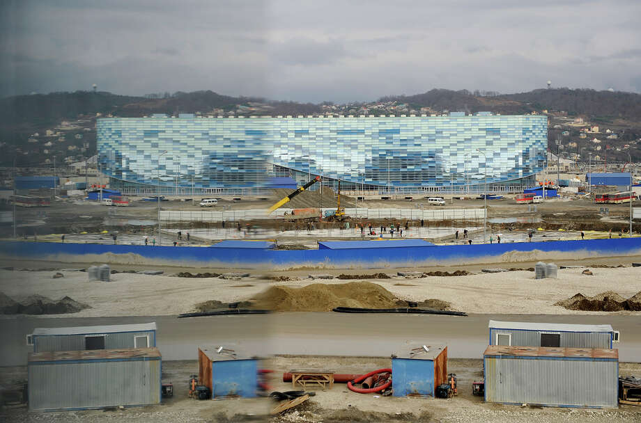 "A picture taken on January 22, 2013, shows a general view of ""Iceberg"" Skating Palace construction site in the Russian Black Sea resort of Sochi. One year before Russia kicks off the 22nd Winter Olympic Games on February 7, 2014, its host city Sochi is one of the world's biggest construction sites, with works proceeding on schedule but declared a disaster by environmentalists. Photo: AFP, AFP/Getty Images / 2013 AFP"