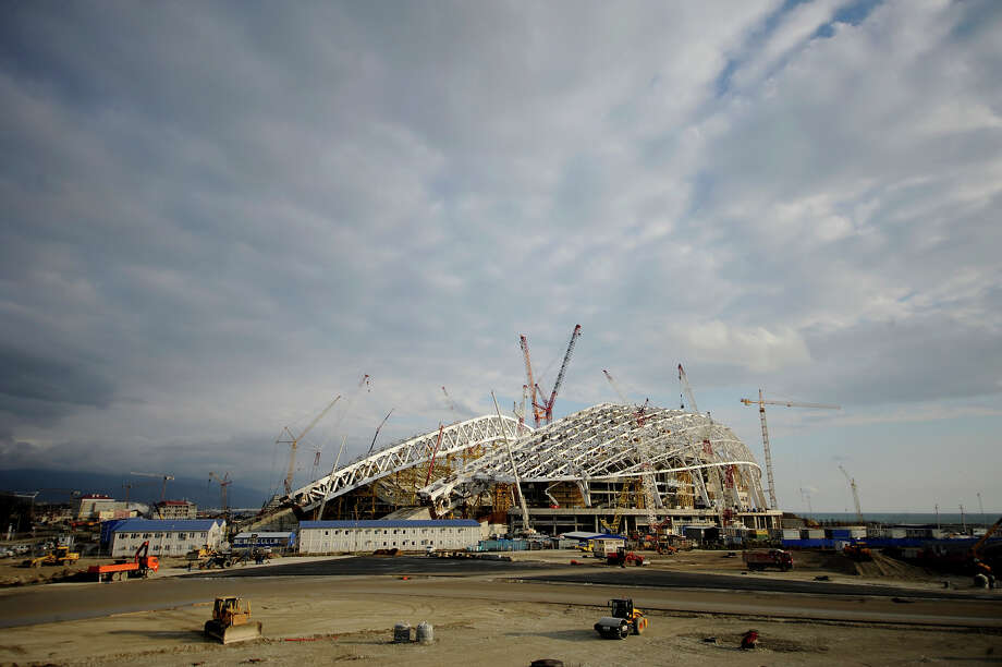 "A picture taken on January 22, 2013, shows a general view of the construction site of ""Fisht"" Olympic Stadium in the Imereti Valley in the Russian Black Sea resort of Sochi. One year before Russia kicks off the 22nd Winter Olympic Games on February 7, 2014, its host city Sochi is one of the world's biggest construction sites, with works proceeding on schedule but declared a disaster by environmentalists. Photo: AFP, AFP/Getty Images / 2013 AFP"