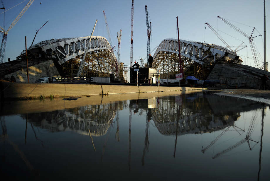 "A picture taken on January 23, 2013, shows a  view of the construction site of ""Fisht"" Olympic Stadium in the Imereti Valley in the Russian Black Sea resort of Sochi. One year before Russia kicks off the 22nd Winter Olympic Games on February 7, 2014, its host city Sochi is one of the world's biggest construction sites, with works proceeding on schedule but declared a disaster by environmentalists. Photo: AFP, AFP/Getty Images / 2013 AFP"